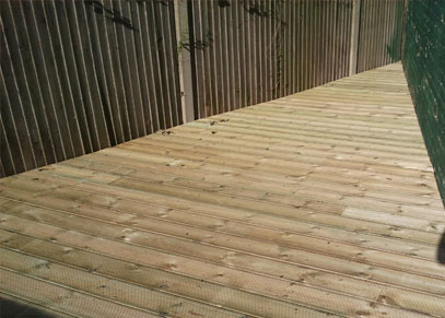 Decking from The Thanet Carpenter in the corner of a garden in Margate